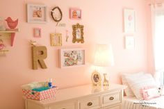 Love the mix of photos and sentimental items in this #nursery #gallerywall