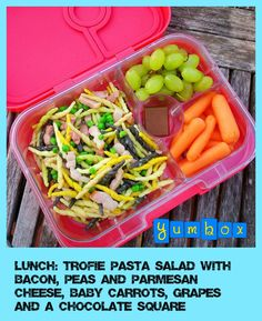 Trofie pasta salad with peas, bacon, parmesan cheese and olive oil. On a side we have baby carrots, grapes and little square of chocolate for dessert. Colorful healthy eating! #packedlunch #schoolLunch #Yumbox