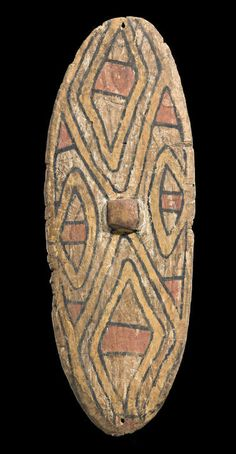 An Early Rainforest Shield, North East Queensland   bears catalogue number 'NEQLD62' on the reverse  natural earth pigments and carved wood  Length: 86.5cm