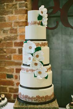 magnolia cake accent, photo by Angela Cox Photography http://ruffledblog.com/notwedding-greenville #weddingcake #cakes
