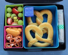 Laptop Lunches bento lunch: soft pretzels, Lego sauce container, homemade chocolate chip granola bar