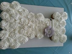 Wedding dress cupcake cake. This was made by our local supermarket Publix. Pretty awesome for $33.