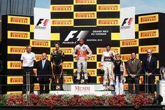 Podium (L to R): Romain Grosjean (FRA) Lotus F1, Lewis Hamilton (GBR) McLaren and Romain Grosjean (FRA) Lotus F1.  Formula One World Championship, Rd7, Canadian Grand Prix, Race, Montreal, Canada, Sunday, 10 June 2012