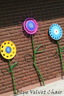 Old hubcaps turned flowers