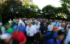 Patrons make their way to the course during Monday's practice round of the 2012 Masters Tournament at Augusta National Golf Club on April 2, 2012, in Augusta, Ga. http://www.Augusta.com