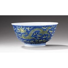AN UNDERGLAZE-BLUE AND YELLOW-GLAZED PORCELAIN 'DRAGON' BOWL, CHINA, QING DYNASTY, KANGXI MARK AND PERIOD (1662-1722)
