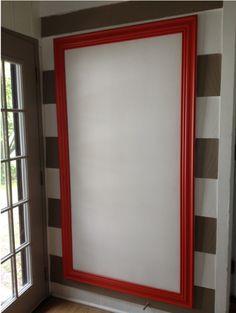 diy bulletin board (as a headboard!) made from homasote & moulding.