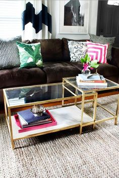 """coffee tables  http://www.refinery29.com/small-space-designer-solutions#slide3  Pair Sleek Metals & Glass  """"Liberally sprinkle your space with lots of glass and metallics. From sweet, little, glass occasional tables to sparkly, metallic vases, these pieces help animate a petite room.""""  — Abigail Ahern"""