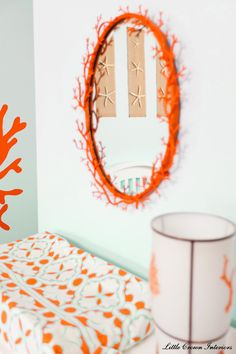 This gorgeous orange, coral mirror adds both color and texture to the nursery.