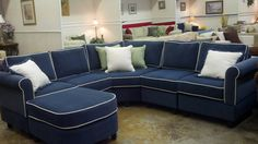"""Small scale Sectional -6 piece Sectional with Wedge Corner in (Kid Proof Fabric) Pippa Navy with Box Cushions and Contrast Welt with Megan Arms. This is a small scale sectional. As shown with 42"""" x 42"""" wedge corner unit the sectional is 95"""" x 95"""". Total depth of each unit is only 30.5"""".  With optional 30"""" x 30"""" corner unit this sectional measures only 83"""" x 83"""" (not including bumper unit.)"""