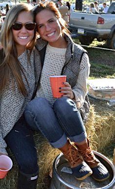 Fashionable friends! :) Patterned long-sleeved shirt + dark skinnies + black Hunters + white sweater + J. Crew herringbone vest + medium wash skinnies + bean boots