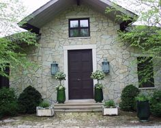 These French glazed pots with ivy topiary set off the front door perfectly. From Deborah Silver at Detroit Garden Works.