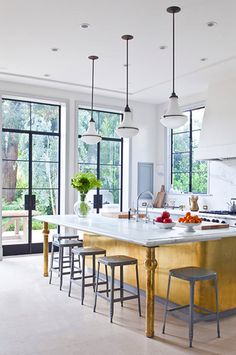 The Most Drop-Dead-Gorgeous Kitchens You've Ever Seen// brass-wrapped island