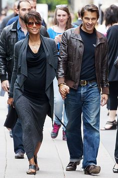 Halle Berry held hands with fiance Olivier Martinez -- the actors are expecting their first child together -- during a stroll through Paris, France, June 11.