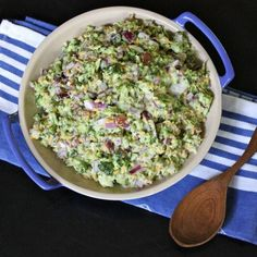 Broccoli Salad. Use chopped broccoli, red onion, match stick carrots, red cabbage & added 2 bags of Crasins & 2 bags of real bacon bits. With dressing.