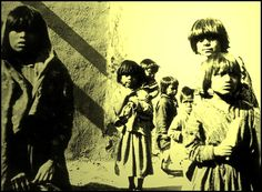 Children of Santo Domingo Pueblo, New Mexico, pose wearing cotton dresses. Photographed: 1913.