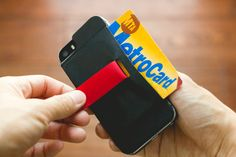 The Wally Stick-On Wallet is a leather pocket that clings tight to hold your items right on the back of your iPhone. Pull the tab to reveal the stash.