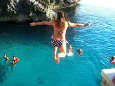 Cliff jumping off Rick's Cafe cliffs in Negril
