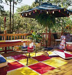 Deck Decor Ideas. Love the rug/umbrella/bright colors, and white cushions + black chairs.