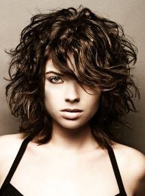 Messy, wavy short hair.  I love the look, my hair only a bit longer than this and naturally wavy, but sure as hell doesn't turn out looking this good lol.