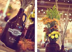 beer growlers as vases for centerpiece..not a fan of these flowers