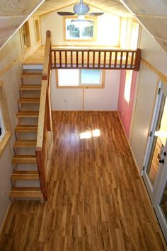 From Molecule Tiny Homes. Another angle of second loft. Love this staircase design in this tiny home and the openess of the ceiling but not that the plans aren't available to the public. Might have to incorporate it into one of the others to get it....hmmm