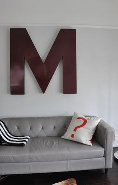 Cool element used on an oversized wall...could be fun to create and eclectic wall of sorts in the front room that speaks family personality without being literal and cheesy?