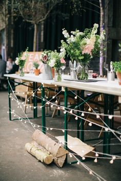 Wedding Photographs at a Camp and Furnace wedding in Lancashire, by Spencer Photography - top table wild flower inspiration, wood, fairy lights