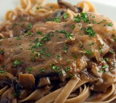 Slow cooker chicken Marsala with fettuccine.Chicken breasts with Marsala wine,mushrooms and fettuccine cooked in slow cooker.
