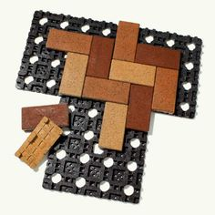 """Azek VAST pavers, by AZEK Building Products Made from recycled tires and plastics, these tough, slip-resistant """"bricks"""" snap onto grids that make quick work of laying patios, driveways, and walkways. Once they're in, you're done—the joints are plenty tight.  About $9 per square foot; azek.com"""