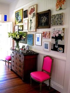 pink chairs/gallery wall