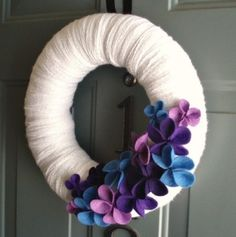 yarn wreath with purple embellishments by ursula