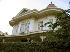 """""""Another heritage house located in San Fernando City, Pampanga is the Santos-Hizon House. This Victorian-style house was built by the couple Teodoro Santos, Jr. and Africa Ventura. It was later purchased by Maria Salome Hizon, a volunteer of the Red Cross during the Philippine Revolution. The property was acquired by her brother Ramon Hizon and is currently owned by the heirs of his son Augusto Hizon."""""""