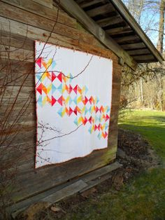 """Cathy from Blueberry Patch made this lovely bright and modern Geometric Slide quilt from a pattern in the new book #VintageQuiltRevival.   """"Straight line quilting was my choice. Lots of straight lines in my favorite #Aurifil 50 wt in white. I just lengthened the stitches a bit and away I went.""""  To read more please visit http://cathy-blueberrypatch.blogspot.com/2014/02/a-finish-geometric-slide.html"""