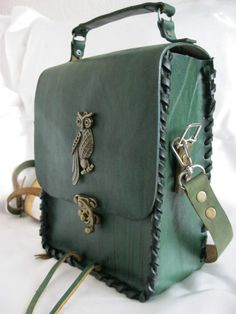 Luxry handmade genuine women's leather shoulder bag with ''OWL'' emblem. $74.99, via Etsy.