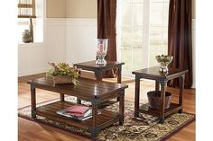 """The Murphy Tables from Ashley Furniture HomeStore (AFHS.com). The rich finish and unique rustic design of the """"Murphy"""" accent table collection creates a warm inviting furniture collection sure to enhance the look and feel of any living room."""
