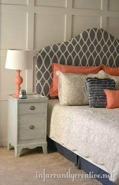 gray and coral bedroom: love the headboard and the coral lamp