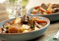 Colorful, hearty and tender, this slow-cooked stew features all the traditional ingredients of a good beef stew: beef, carrots, onion, potatoes, peas in a rich gravy.