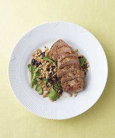 Serve the pork with farro—a delicious, nutty grain—dressed up with spicy arugula and sweet dried cherries. Get the recipe for Herbed Pork Tenderloin With Lemony Farro and Arugula.