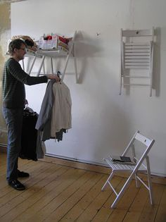 LOVE THIS!  Hang a folding chair on the wall - unfold and it is a shelf and clothing rod for a guest. Great for a beach house! 30 Creative Ways to Repurpose & Reuse Old Stuff | Bored Panda