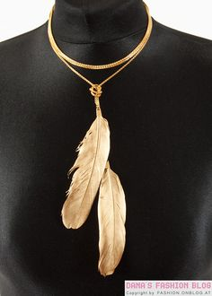 gold feather necklace.