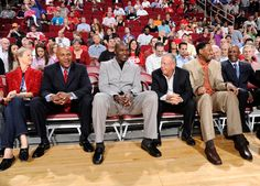 Mario Elie, Hakeem Olajuwon, Rockets owner Leslie Alexander, Robert Horry and Clyde Drexler sit court-side at the Rockets' Team of the 90s night