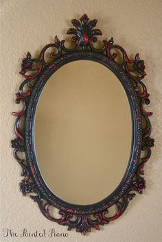 Ornate mirror - black with red accents