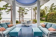 Blue and white Patio with a water view...