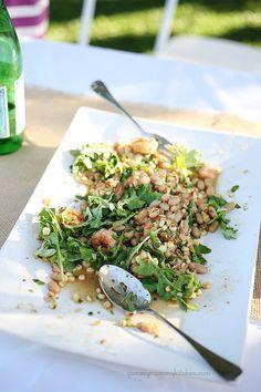 Shrimp, white bean and corn salad over arugula.  http://clvr.li/spellegrinosweeps #LiveOffTheMenu #SanPellegrino #sponsored