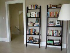 love these leaning ladder shelves. from Target - $120/each