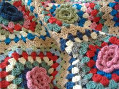 Crochet throw with floral relief