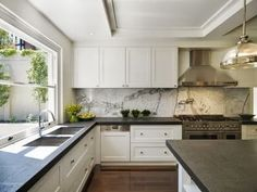 statuary marble and honed Absolute black granite (a good substitute if Soapstone is not available) granite backsplash, statuary marble kitchen, absolut black, cabinet design, hous, kitchen trend, black granit, dream kitchens, white kitchens