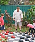outdoor checkers made with pavers and rocks!