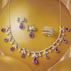 "A Regal Look! Amethyst & Diamond Bow Earrings. Go formal or casual in these versatile bow ties. Sterling silver with pear-shaped amethysts and diamonds. This antique-inspired Amethyst and Diamond Necklace presents pear-shaped amethysts and diamonds in a dramatic, draping style. Sterling silver with 3"" extender. Set of Three White Topaz and Diamond Eternity Bands. >>Click on the pin to shop these styles.  #amethyst #diamond #gemstone #necklace #earrings #ringset #RossSimons"